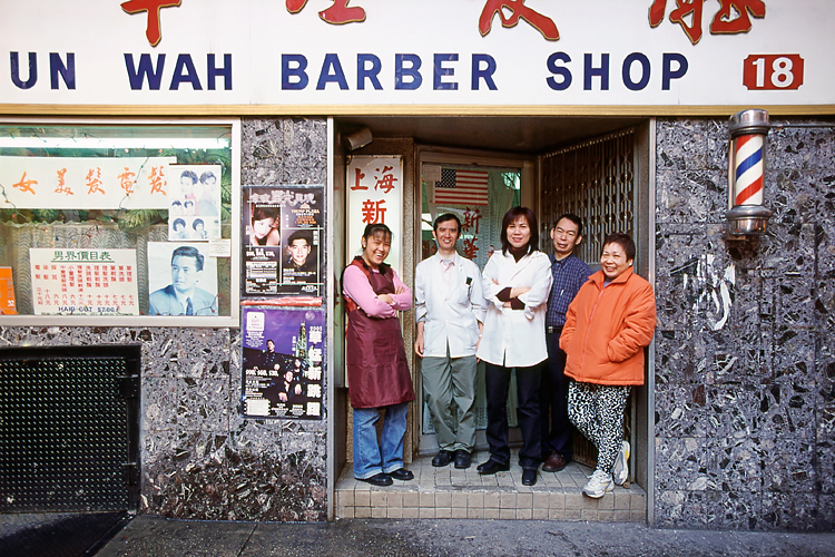 Family Pose in Front of their Hair Salon